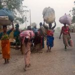 people-fleeing-their-community-for-safety83069071.jpg