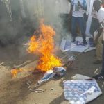 Shiites-protesters-burn-down-US-Israeli-national-flags-in-Abuja-653x365.jpg